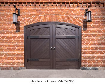 brick wall with arch and wooden door