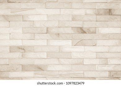 Brick wall art concrete stone texture background in wallpaper limestone abstract paint to flooring and homework/Brickwork or stonework clean grid uneven interior rock old.