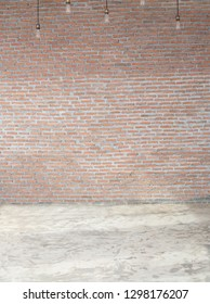 Brick wall background with bulbs and concrete floor