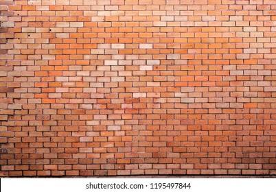 Brick wall background with dark orange background decorated with beautiful background.