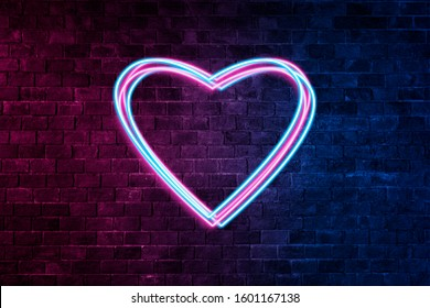 Brick wall, background, neon light.Neon Light Symbol Heart . Collection Valentine neon signs.Celebration Concept. symbols of love for Happy Women's, Mother's, Valentine's Day, birthday greeting card d