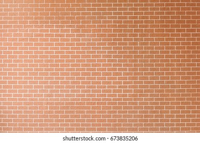Brick wall background. Orange wall with brick pattern. closed up of brick pattern wall. brick-like landscape mural background.
