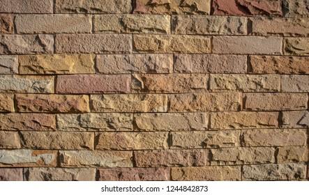 Brick wall background. Red brick wall. Rugged wall background. Rugged texture wallpaper.