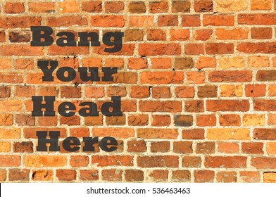 Brick wall with Bang Your Head Here concept