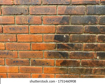 Brick wall before and after pressure washing to clean off the dirt and grime