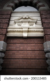 Brick wall blocking the factory doorway for a businessman concept for conquering adversity, business obstacle trapped or no way out