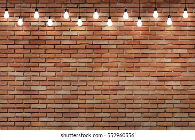 brick wall with bulb lights lamp. nice brick show room with spotlights.