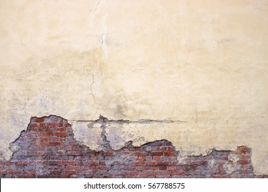 brick wall with damaged plaster, background