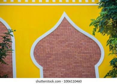 Brick wall decoration that plastering and yellow painted. Red brick wall and yellow plastering background with copy space for text.