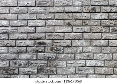 brick wall of decorative gray stone. background