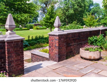 A brick wall with an entrance into the garden in Mellon Park on a summer day, Pittsburgh, Pennsylvania, USA