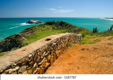 Brick wall in the front, Caribbean sea in the back. Margarita Island, Venezuela.