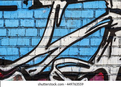Brick wall with grafitti. Colorful painted close up