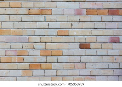 Brick wall with gray and orange hues - Background pattern
