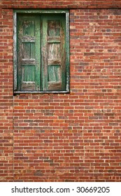 brick wall with high wooden door