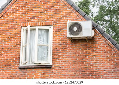 Brick wall of home with window and air conditioner