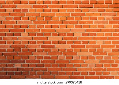 A brick wall lighted by the setting sun