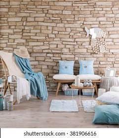 brick wall lounge chair blue pillow and hat old rock relax decor