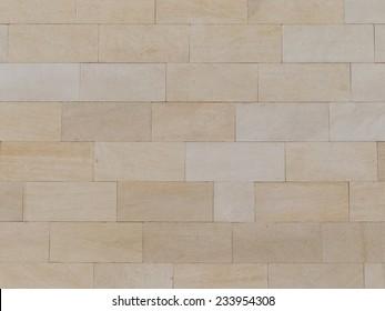 brick wall made �¢??�¢??of light beige natural travertine