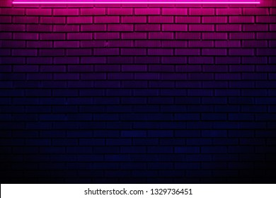 Brick wall in neon light.