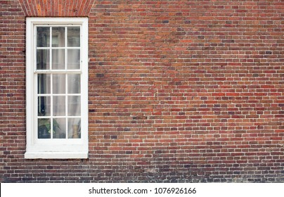 Brick wall with only one window house front / facade in popular and wanted neighborhoods close to the city center.