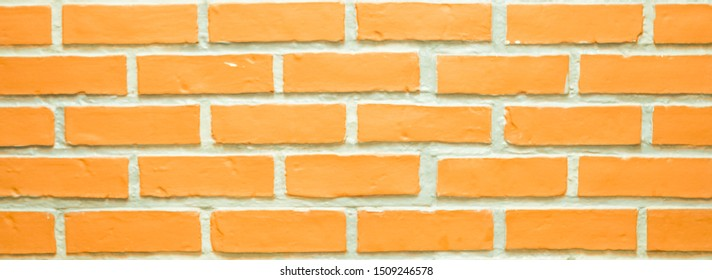 The brick wall in orange color looks colorful and classic for interior or home office.