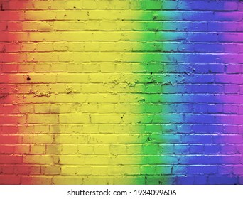 A brick wall painted in a rainbow color