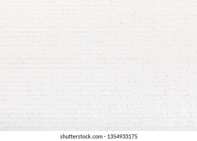 Brick wall painted with white paint. White Loft background, texture, copy space