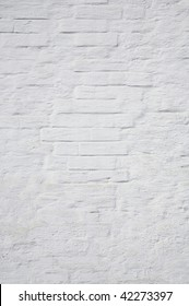 The brick wall painted with a white paint