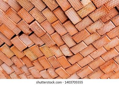 Brick wall pattern. Industrial texture. Orange bricks background