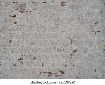 Brick wall with plastered plaster
