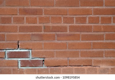 brick wall red cracked old background pattern