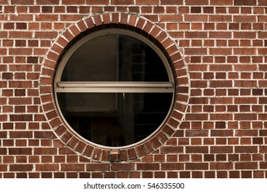 brick wall with a round window