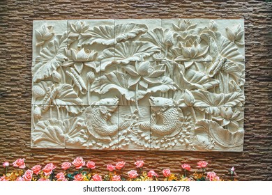 brick wall and stone carving with rose