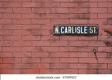 Brick Wall with a street name mounted on it in Philadelphia