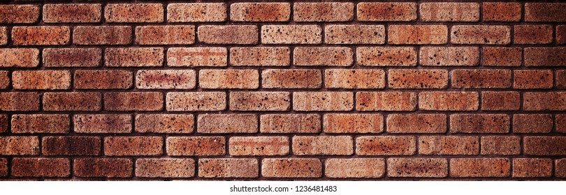 Brick wall texture or background. Brick line are perpendicular to shot dimension.  Light brown colored bricks.
