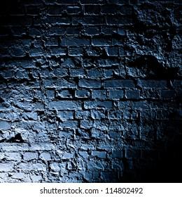 Brick wall texture. Dark contrast shadows.