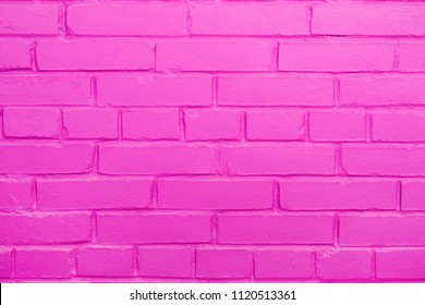 Brick wall texture, pink background with copy space
