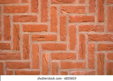 Brick wall using a diagonal herringbone pattern bond