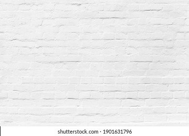 Brick wall with white plastering, seamless background photo texture