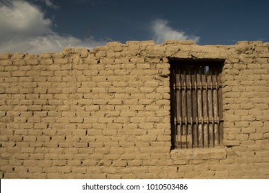 A brick wall with window