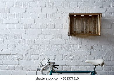 brick wall with wine case and road bike