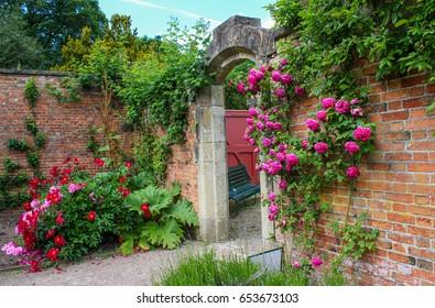 Brick walled garden with secret doorway