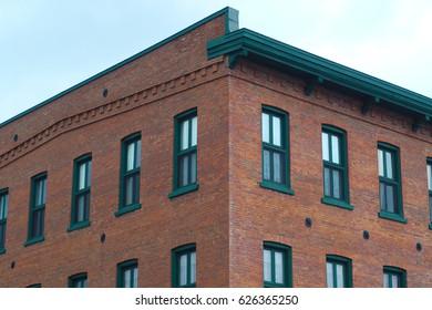 brick and windows city building architecture corner angle