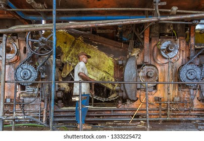 Brickaville, Madagascar, November 8, 2014: A Malagasy worker repairing the engine of the sugar refinery of Brickaville, east of Madagascar.