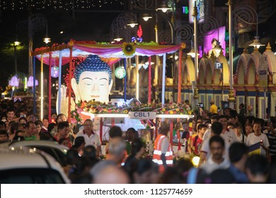 BRICKFIELDS, MALAYSIA - 29 MAY 2018 : Wesak procession floats vehicles and buddhist pilgrims marching on Tun Sambanthan road, Brickfields, Malaysia during wesak festival.