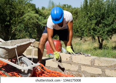 bricklayer building a new wall