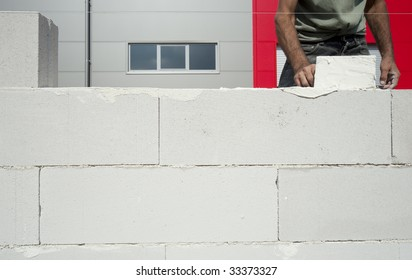 Bricklayer building the wall
