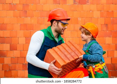 Bricklayer make masonry, builder work with brick layer. Brothers at work. Small child boy repairing in workshop