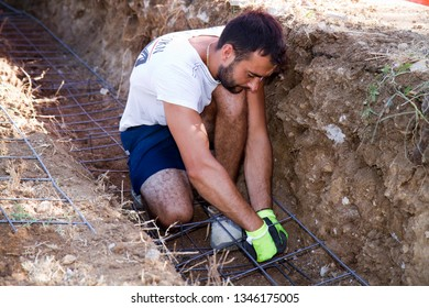bricklayer making a substructure for a wall